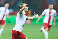 Poland's Sebastian Mila celebrates after scoring during the EURO 2016 qualifying match between Poland and Germany on October 11, 2014 at the National stadium in Warsaw, Poland<br /> <br /> Picture also available in RAW (NEF) or TIFF format on special request.<br /> <br /> For editorial use only. Any commercial or promotional use requires permission.<br /> <br /> Mandatory credit:<br /> Photo by © Adam Nurkiewicz / Mediasport