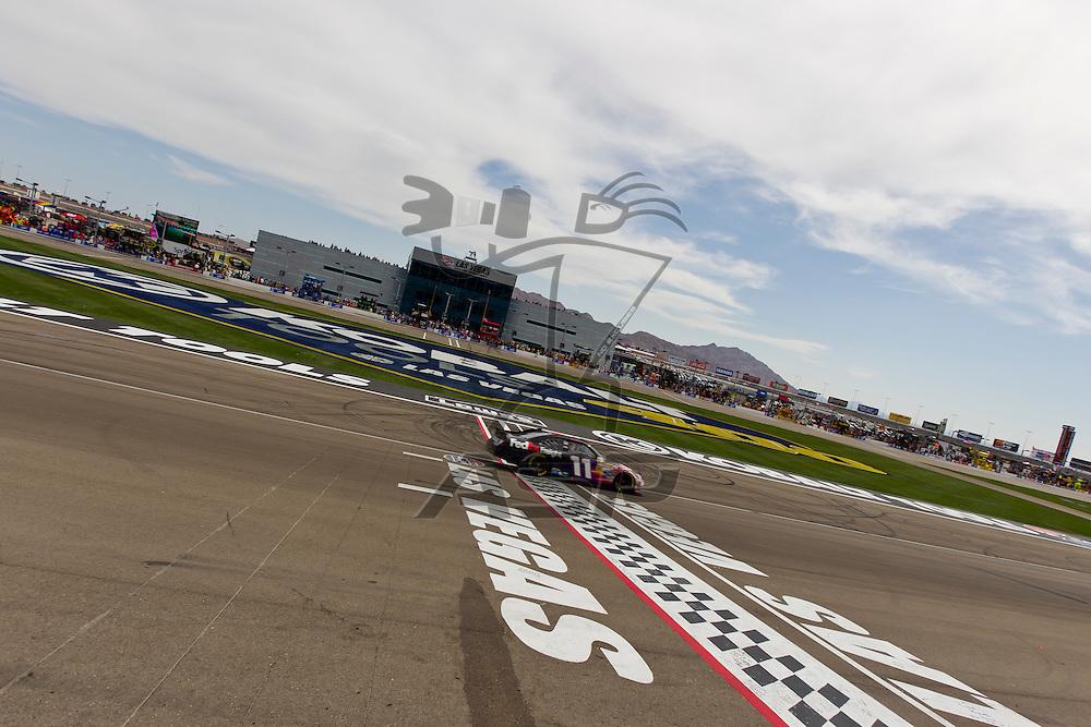 LAS VEGAS, NV - MAR 11, 2012:  Denny Hamlin (11) crosses the finish line at the Kobalt Tools 400 NASCAR race in Las Vegas, NV.
