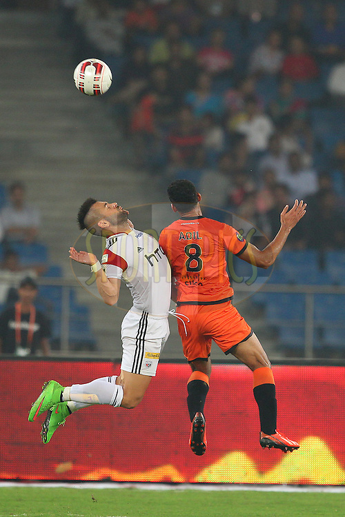Tomas Josl of NorthEast United FC and Adil Khan of Delhi Dynamos FC during match 16 of the Hero Indian Super League between The Delhi Dynamos FC and NorthEast United FC held at the Jawaharlal Nehru Stadium, Delhi, India on the 29th October 2014.<br /> <br /> Photo by:  Ron Gaunt/ ISL/ SPORTZPICS