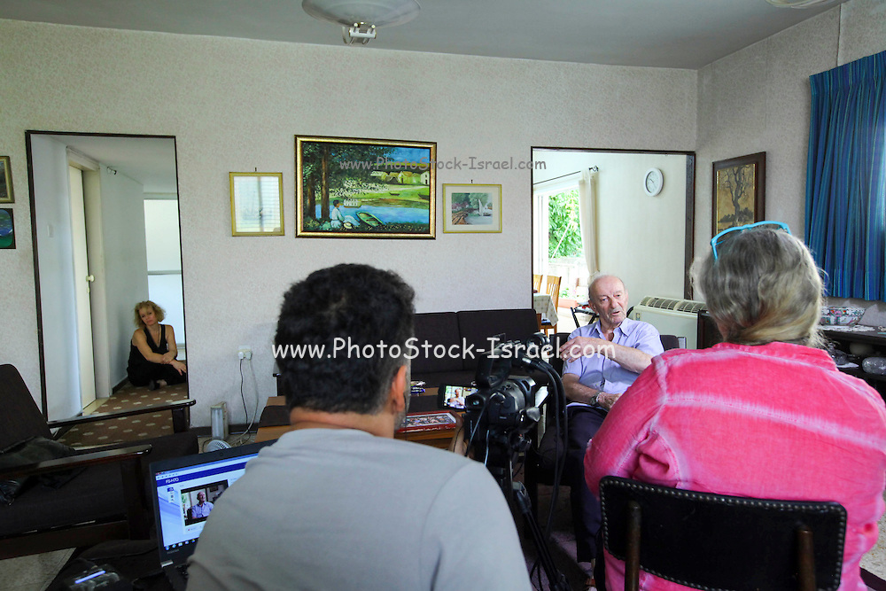86 years old Avraham Avraham is being interviewed infront of a video camera by the Yad Vashem archive organization, giving testimony of his life before and during the Holocaust and world war II