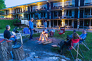 Our crew gathers around a campfire at The Hub motorcycle resort after the first day of riding.