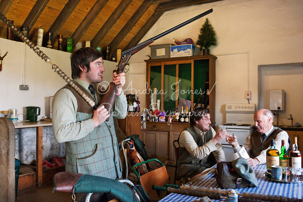 Head Keeper of Teasses Estate, Ceres, Fife with sons cleaning guns