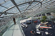 "Hangar-7; the spectacular home of the Flying Bulls (""Red Bull"" owner Didi Mateschitz' collection of classic airplanes) next to Salzburg W.A. Mozart airport. Walkway to Threesixty Bar.Original X-Wing Starfighter from ""Star Wars"" parked next to a Red Bull Formula One racing car themed ""Star Wars Episode III: Revenge of the Sith"", as driven by David Coulthard and Vitantonio Liuzzi in the 2005 Monaco Grand Prix."