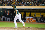 Oakland Athletics shortstop Marcus Semien (10) watches the ball leave the Oakland Coliseum as he hits a Grand Slam against the San Francisco Giants at Oakland Coliseum in Oakland, California, on July 31, 2017. (Stan Olszewski/Special to S.F. Examiner)