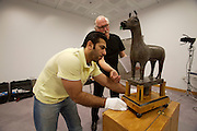 Al Waiba military base, state of Qatar art depot. Photographing artefacts destined for the new Museum of Islamic Art. Djamila, the hind water thrower.