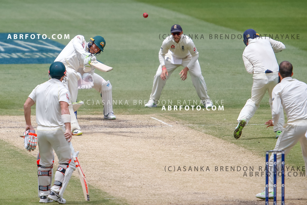 Usman Khawaja hits Moeen Ali for six during day 4 of the 2017 boxing day test.