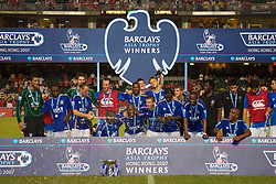 Hong Kong, China - Friday, July 27, 2007: Portsmouth's players celebrate with the trophy after a penalty shoot-out victory over Liverpool during the final of the Barclays Asia Trophy at the Hong Kong Stadium. (Photo by David Rawcliffe/Propaganda)