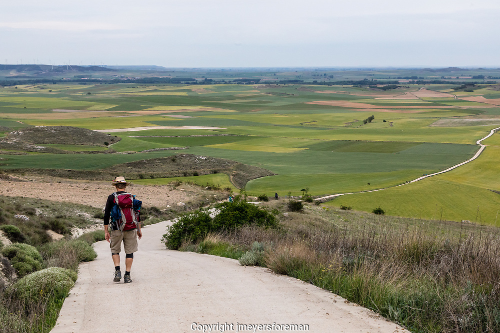 walking down the Camino path from Alto de Mostelares beautiful views of the the Meseta