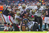 06 October 2013: Running back (22) Matt Forte of Chicago Bears is tackled by the New Orleans Saints defense during the first half of the Saints 26-18 victory over the Bears in an NFL Game at Soldier Field in Chicago, IL.