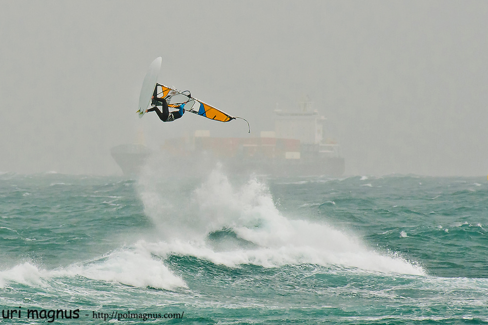 this photo win google photography prize , top 100.<br /> storm rider event of wind surfing in haifa,israel.