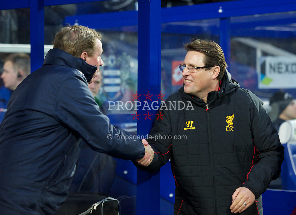 LONDON, ENGLAND - Sunday, December 30, 2012: Liverpool's assistant manager Colin Pascoe, standing in for manager Brendan Rodgers who is ill, shakes hands with Queens Park Rangers' manager Harry Redknapp before the Premiership match at Loftus Road. (Pic by David Rawcliffe/Propaganda)