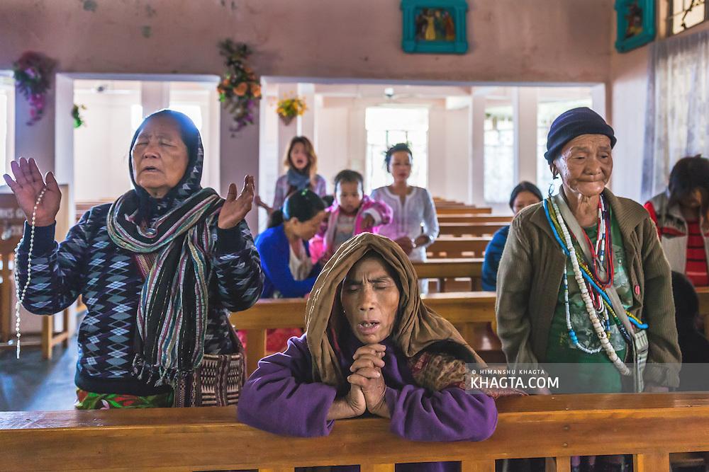 Newly converted tribals attending a mass at St Joseph Catholic Church, Nyokum Lapang, Itanagar