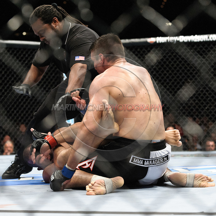 "LAS VEGAS, NEVADA, MAY 24, 2008: Referee Herb Dean (facing) steps in and ends the fight between Goran Reljic (top) and Wilson Gouveia during ""UFC 84: Ill Will"" inside the MGM Grand Garden Arena in Las Vegas"