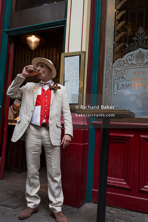 A lunchtime drinker enjoys a pint at a pub in Leadenhall Market in the capital's financial district (aka The Square Mile), on 23rd April, City of London, England. (Photo by Richard Baker / In Pictures via Getty Images)