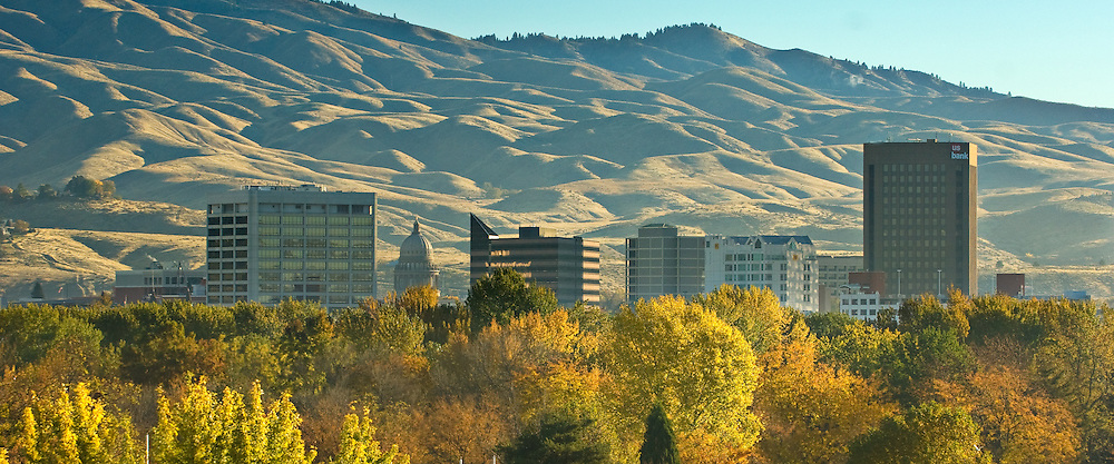 Idaho. Boise skyline with fall colors of Ann Morrison Park and foothills beyond.