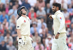 England's Dominic Bess reacts after getting out on 49 from the bowling of Pakistan's Shadab Khan (right) during day two of the Second Natwest Test match at Headingley, Leeds.