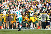 GREEN BAY, WI - OCTOBER 17: Greg Jennings #85 of the Green Bay Packers catches a deep pass against the Miami Dolphins at Lambeau Field on October 17, 2010 in Green Bay, Wisconsin. The Dolphins defeated the Packers 23-20 in overtime. (Photo by Tom Hauck) Player:Greg Jennings