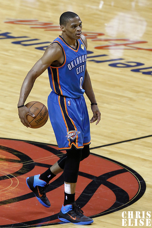 17 June 2012: Oklahoma City Thunder point guard Russell Westbrook (0) brings the ball upcourt during the Miami Heat 91-85 victory over the Oklahoma City Thunder, in Game 3 of the 2012 NBA Finals, at the AmericanAirlinesArena, Miami, Florida, USA.