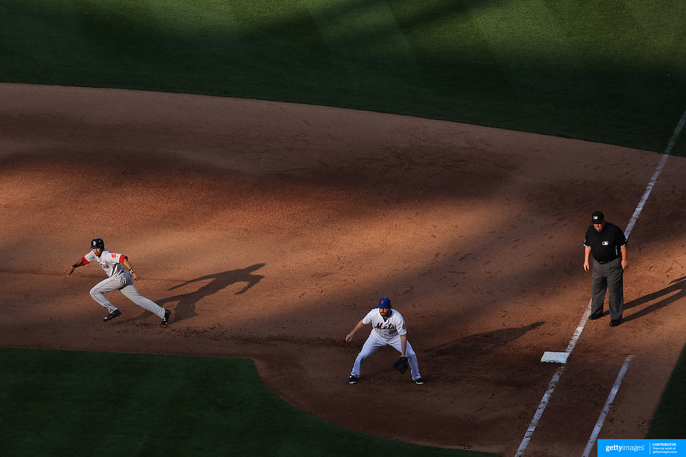 Mookie Betts, Boston Red Sox, runs to second on a hit in the late afternoon sunlight during the New York Mets Vs Boston Red Sox MLB regular season baseball game at Citi Field, Queens, New York. USA. 29th August 2015. Photo Tim Clayton