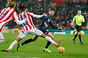 Leeds United midfielder Jordan Stevens (48)  goes past Stoke City defender Ashley Williams (5) during the EFL Sky Bet Championship match between Stoke City and Leeds United at the Bet365 Stadium, Stoke-on-Trent, England on 19 January 2019.
