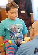 "Volunteer, and Penn Memory Center patient Leslie Wolff  entertains Jacob Taylor (left), 9, with his puppets Tuesday, September 05, 2017 at CHOP Care Network in Philadelphia, Pennsylvania. The Penn Memory Center, which serves people with dementia mild cognitive disorder, has a new volunteer partnership with CHOP. Its patients and ""normal controls"" volunteer with CHOP patients. (WILLIAM THOMAS CAIN / For The Philadelphia Inquirer)"