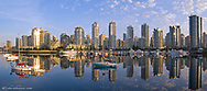 Looking across False Creek at the skyline of Vancouver British Columbia at sunrise