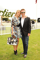 HOLLY VALANCE and NICK CANDY at the Cartier International Polo at Guards Polo Club, Windsor Great Park, Berkshire on 25th July 2010.