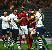 Tempers rise as both sets of players clash during the Sky Bet Championship match between Preston North End and Nottingham Forest at Deepdale, Preston, England on 3 November 2015. Photo by Pete Burns.