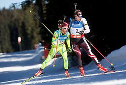 BAUER Klemen of Slovenia and LANDERTINGER Dominik of Austria compete during Men 12.5 km Mass Start competition of the e.on IBU Biathlon World Cup on Sunday, March 9, 2014 in Pokljuka, Slovenia. Photo by Vid Ponikvar / Sportida