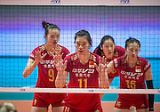 The Chinese team poised for the next point. Left CHANGNING ZHANG,2nd left YUNLI XU and (R)XIA DING. FIVB Volleyball World Grand Prix Hong Kong 2016. USA secure a 3-0 win over China at the Hong Kong Coliseum with scores of 25-19,25-21,25-17