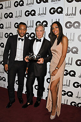 Left to right, JOHN LEGEND, Designer of The Year TOMMY HILFIGER and ROSARIO DAWSON at the GQ Men of the Year 2011 Awards dinner held at The Royal Opera House, Covent Garden, London on 6th September 2011.