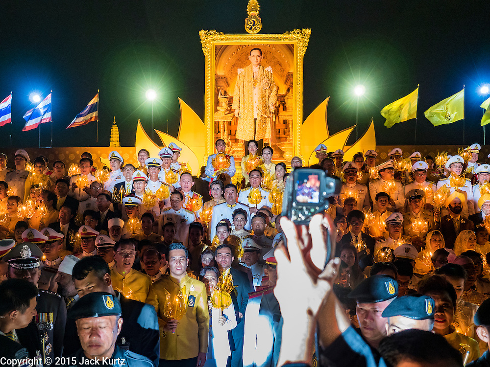 05 DECEMBER 2015 - BANGKOK, THAILAND:  People hold up lanterns and candles during the celebration of the King's Birthday on Sanam Luang in Bangkok. Thais marked the 88th birthday of Bhumibol Adulyadej, the King of Thailand,  Saturday. The King was born on December 5, 1927, in Cambridge, Massachusetts. The family was in the United States because his father, Prince Mahidol, was studying Public Health at Harvard University. He has reigned since 1946 and is the world's currently the longest serving monarch in the world and the longest serving monarch in Thai history. Bhumibol, who is in poor health, is revered by the Thai people. His birthday is a national holiday and is also celebrated as Father's Day. He is currently hospitalized in Siriraj Hospital, recovering from a series of health setbacks.   PHOTO BY JACK KURTZ