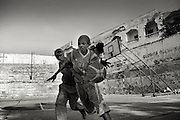 Death or Play. Women&acute;s Basketball in Mogadishu<br /> Women's basketball? In Europa and the U.S., we take it for granted. But consider this: In Mogadishu, war-torn capital of Somalia, young women risk their lives every time they show up to play.<br /> Suweys, the captain of the Somali women&acute;s basketball team, and her friends play the sport of the deadly enemy, called America. This is why they are on the hit list of the killer commandos of Al Shabaab, a militant islamist group, that has recently formed an alliance with the terrorist group Al Qaeda and control large swathes of Somalia.<br /> <br /> Al Shabaab, who sets bombs under market stands, blows up cinemas, and stones women, has declared the female basketball players &bdquo;un-islamic&ldquo;. One of the proposed punishments is to saw off their right hands and left feet. Or simply: shoot them.<br /> <br /> Suweys&acute; team trains behind bullet-ridden walls, in the ruins of the failed city of Mogadishu &ndash; protected by heavily armed gun-men. The women live in constant fear of the islamist killer commandos. Stop playing basketball? Never, they say.<br /> Women&acute;s basketball in the world&acute;s most dangerous capital. Female basketball in Mogadishu, Somalia.<br />