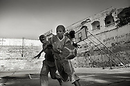 """Death or Play. Women´s Basketball in Mogadishu<br /> Women's basketball? In Europa and the U.S., we take it for granted. But consider this: In Mogadishu, war-torn capital of Somalia, young women risk their lives every time they show up to play.<br /> Suweys, the captain of the Somali women´s basketball team, and her friends play the sport of the deadly enemy, called America. This is why they are on the hit list of the killer commandos of Al Shabaab, a militant islamist group, that has recently formed an alliance with the terrorist group Al Qaeda and control large swathes of Somalia.<br /> <br /> Al Shabaab, who sets bombs under market stands, blows up cinemas, and stones women, has declared the female basketball players """"un-islamic"""". One of the proposed punishments is to saw off their right hands and left feet. Or simply: shoot them.<br /> <br /> Suweys´ team trains behind bullet-ridden walls, in the ruins of the failed city of Mogadishu – protected by heavily armed gun-men. The women live in constant fear of the islamist killer commandos. Stop playing basketball? Never, they say.<br /> Women´s basketball in the world´s most dangerous capital. Female basketball in Mogadishu, Somalia.<br /> A deadly game.."""