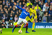 James Tavernier (#2) of Rangers FC is fouled by Ramiro Funes Mori (#4) of Villarreal CF during the Europa League group stage match between Rangers FC and Villareal CF at Ibrox, Glasgow, Scotland on 29 November 2018.