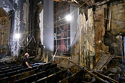 Volunteer Stanley Pokras attempts to light out a decoration found inside the auditorium of the Uptown Theatre as visitors had the chance to tour the dilapidated structure during this year's Philly Free Streets, on Saturday. (Bastiaan Slabbers for WHYY)