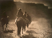Native American Indians: The vanishing race: A group of mounted Navajo riding into the distance.  c1904. Photograph by Edward Curtis (1868-1952).  nAVAJO