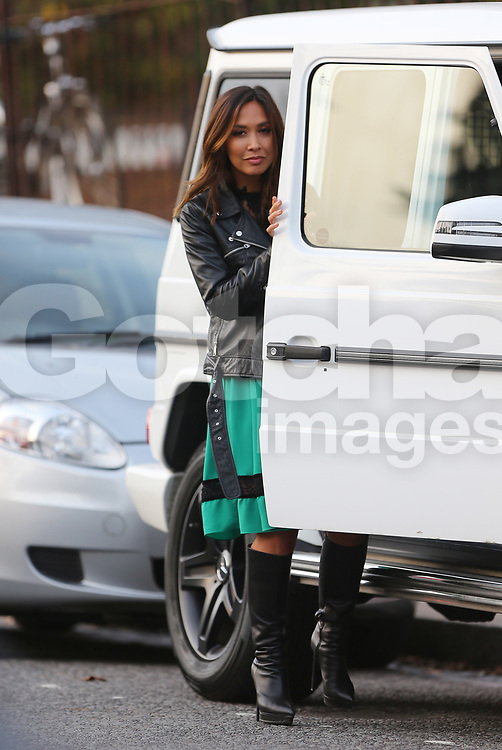 (EXCLUSIVE PICTURES) Myleene Klass wearing a black leather bikers jacket, green dress with black lace and a pair of knee high boots with 6-inch heels out and about in London, UK. 03/11/2017<br />