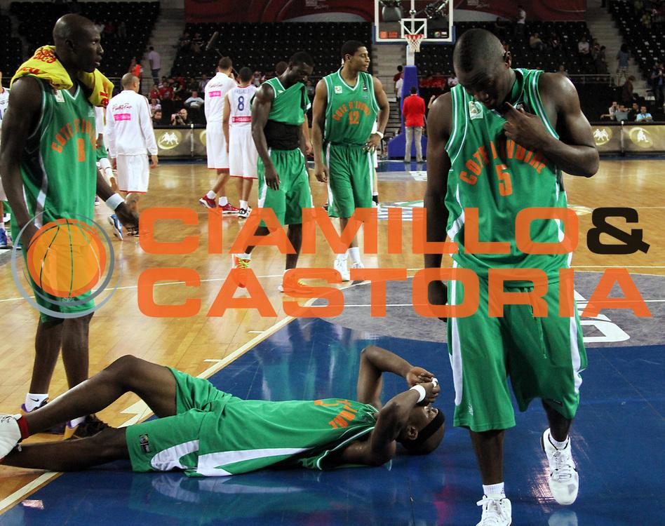 DESCRIZIONE : Ankara Turchia Turkey Men World Championship 2010 Campionati Mondiali Puerto Rico Cote d'Ivoire<br /> GIOCATORE : Team Cote d'Ivoire Team Costa d'Avorio<br /> SQUADRA : Cote d'Ivoire Costa d'Avorio<br /> EVENTO : Ankara Turchia Turkey Men World Championship 2010 Campionato Mondiale 2010<br /> GARA : Puerto Rico Cote d'Ivoire Portorico Costa d'Avorio<br /> DATA : 02/09/2010<br /> CATEGORIA : delusione<br /> SPORT : Pallacanestro <br /> AUTORE : Agenzia Ciamillo-Castoria/A.Vlachos<br /> Galleria : Turkey World Championship 2010<br /> Fotonotizia : Ankara Turchia Turkey Men World Championship 2010 Campionati Mondiali Puerto Rico Cote d'Ivoire<br /> Predefinita :
