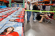 "Dec. 1, 2009 -- TEMPE, AZ: People wait in line at the Costco in Tempe, AZ, to get Sarah Palin's autograph in her book, ""Going Rogue."" Former Alaska Governor Sarah Palin signed copies of her book, ""Going Rogue"" at a Costco in Tempe, AZ, Tuesday. More than one thousand people showed up for the signing. About 150 of them spent the night at the store. Palin did not make any comments or speak to the address during her appearance in Tempe.  Photo by Jack Kurtz"