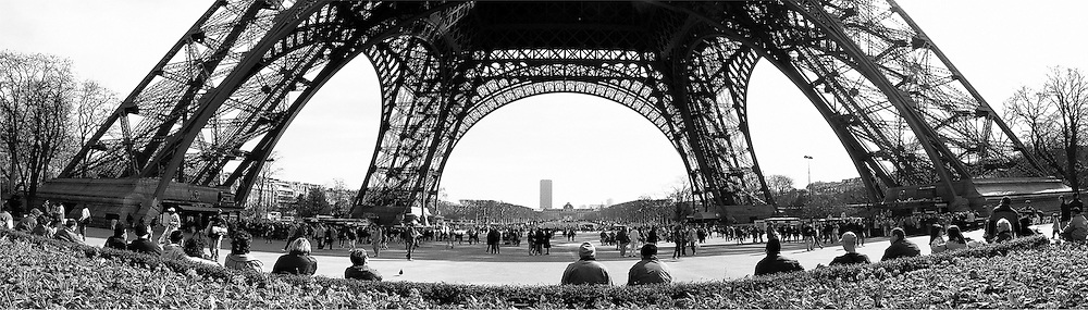 Waiting under the Eiffel Tower, Paris, France.<br /> Image made on a small digital camera with pixellation exaggerated for effect.