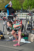 Anna Moore, an Ohio University senior, changes and stretches after completing the biking route for the Race for a Reason triathlon, Saturday, April 27, 2013. The triathlon included a 500mm Serpentine Swim at the Ohio University Aquatic Center, a 15 mile bike ride to the Plains and back and then a 5k run that finished at Tailgreat Park across from Peden Stadium. . Race for a Reason, Race 4 A Reason, Annual Events, Events, Students, Faculty & Staff