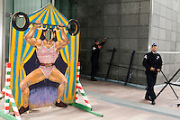 Another eu summit. A circus stand stands in front of EU buildings, while police protects the EU against protests