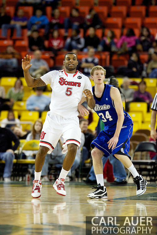 November 26th, 2010:  Anchorage, Alaska - St. John's senior forward Sean Evans (5) is defended by Drake Bulldog sophomore forward Ben Simons (34) in the Bulldog's loss to St. Johns at the Great Alaska Shootout.  The Red Storm defense held Drake to a tournament low score as St. Johns advanced to the final game 82-39.