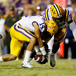 Sep 25, 2010; Baton Rouge, LA, USA; LSU Tigers cornerback Tyrann Mathieu (14) picks up a fumble during the first half at Tiger Stadium.  Mandatory Credit: Derick E. Hingle