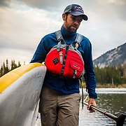 Cody Downard models standup paddleboarding in the Tetons near Jackson, Wyoming.