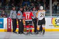 KELOWNA, CANADA - DECEMBER 3: Rodney Southam #17 of the Kelowna Rockets and Tyler Coulter #21 of the Brandon Wheat Kings stand with ice officials after a line brawl on December 3, 2016 at Prospera Place in Kelowna, British Columbia, Canada.  (Photo by Marissa Baecker/Shoot the Breeze)  *** Local Caption ***