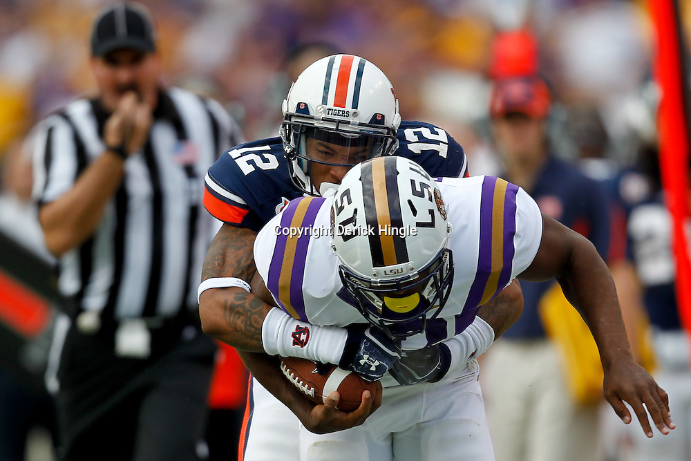 October 22, 2011; Baton Rouge, LA, USA; Auburn Tigers defensive back Demetruce McNeal (12) tackles LSU Tigers running back Michael Ford (42)during the second half at Tiger Stadium. LSU defeated Auburn 45-10. Mandatory Credit: Derick E. Hingle-US PRESSWIRE / © Derick E. Hingle 2011