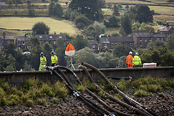 © Licensed to London News Pictures. 03/08/2019. Whaley Bridge, UK. The town of Whaley Bridge in Derbyshire remains evacuated after heavy rain caused damage to a slipway on the Toddbrook Reservoir , threatening homes and businesses with flooding. Photo credit: Joel Goodman/LNP