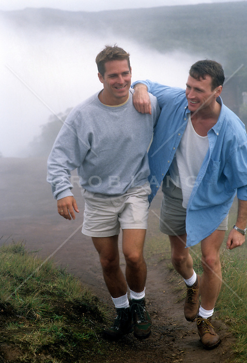 two gay men walking together in Kauai, Hawaii